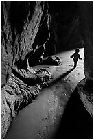 Infant walking out of sea cave. Bandon, Oregon, USA (black and white)