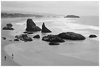 Beach at Face Rock with two people walking. Bandon, Oregon, USA ( black and white)