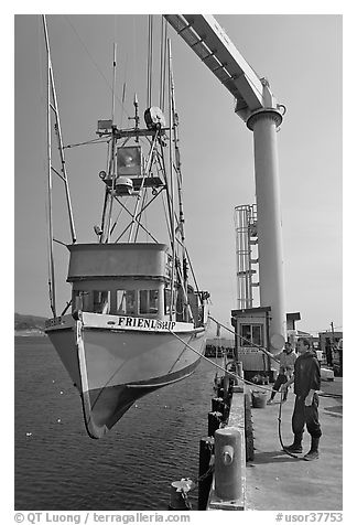 Fishing boat hoisted from water, Port Orford. Oregon, USA (black and white)
