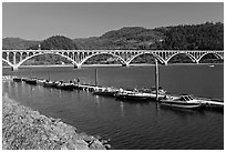 Boat deck and Isaac Lee Patterson Bridge over the Rogue River. Oregon, USA ( black and white)