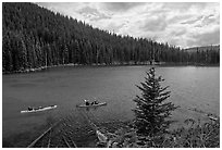 Kayaks on emerald waters, Devils Lake, Deschutes National Forest. Oregon, USA ( black and white)
