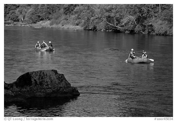 Two Rafts passing boulder, McKenzie river. Oregon, USA (black and white)