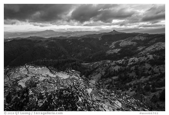 Outcrop and distant Pilot Rock, Hobbart Point. Cascade Siskiyou National Monument, Oregon, USA (black and white)