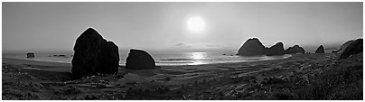 Pacific coastal scenery with setting sun, Pistol River State Park. Oregon, USA (Panoramic black and white)