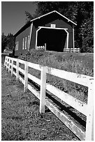 Fence and red covered bridge, Willamette Valley. Oregon, USA (black and white)