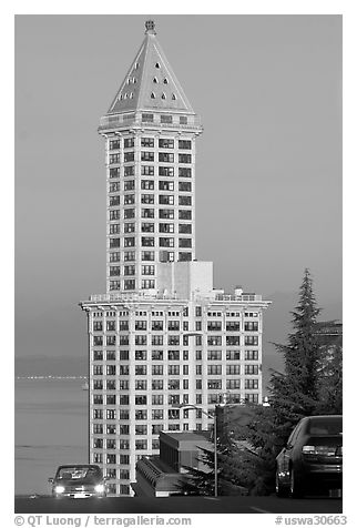 Smith Tower and cars on steep street, early morning. Seattle, Washington (black and white)