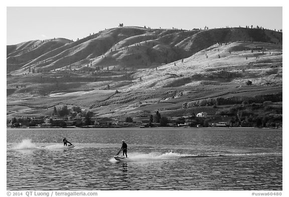 Personal watercraft riders and vineyard covered hills, Lake Chelan. Washington (black and white)