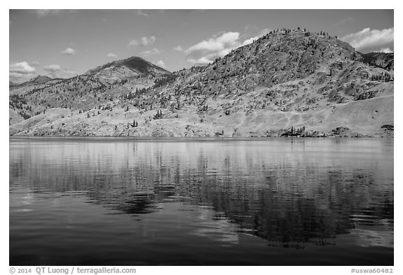 Dry hills reflected in Lake Chelan. Washington (black and white)