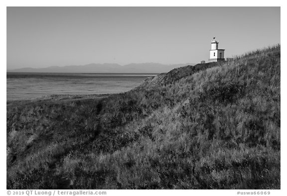 Grassy hill with lighthouse, Cattle Point Natural Resources Conservation Area, San Juan Islands National Monument. Washington (black and white)