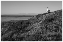 Grassy hill with lighthouse, Cattle Point Natural Resources Conservation Area, San Juan Islands National Monument. Washington ( black and white)