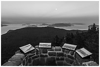 Interpretive signs on top of Ellsworth Storey Tower at sunset, Moran State Park. Washington ( black and white)