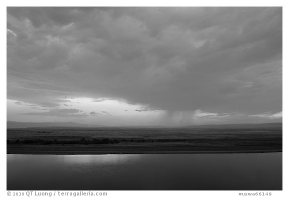 Columbia River and distant rainstorm at sunset, Hanford Reach National Monument. Washington (black and white)