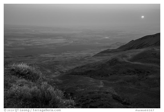 Sun rising in haze over Saddle Mountain, Hanford Reach National Monument. Washington (black and white)