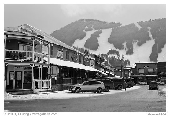 Town square stores and ski slopes in winter. Jackson, Wyoming, USA (black and white)