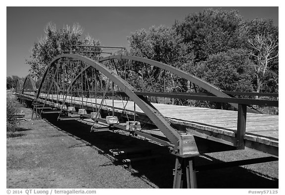 Three-span bowstring through truss bridge over the North Platte River. Fort Laramie National Historical Site, Wyoming, USA (black and white)
