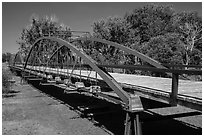 Three-span bowstring through truss bridge over the North Platte River. Fort Laramie National Historical Site, Wyoming, USA ( black and white)