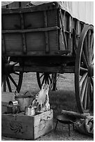 Pionneer wagon and camp gear. Fort Laramie National Historical Site, Wyoming, USA ( black and white)