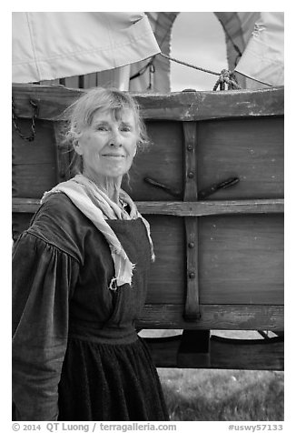 Woman dressed as pionneer. Fort Laramie National Historical Site, Wyoming, USA (black and white)
