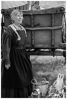 Woman with Pionneer wagon. Fort Laramie National Historical Site, Wyoming, USA ( black and white)
