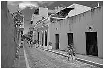 Cobblestone street and colorful houses, old town. San Juan, Puerto Rico (black and white)