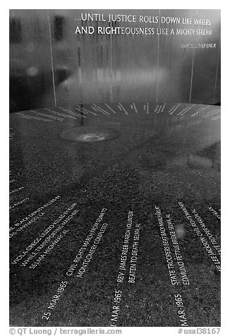 Table and wall with flowing water, Civil Rights Memorial. Montgomery, Alabama, USA (black and white)