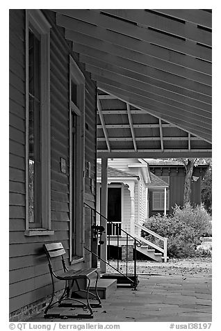 Porch, bench, and buildings in Old Alabama Town. Montgomery, Alabama, USA (black and white)