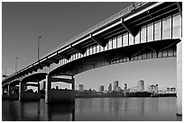 Skyline framed by bridge at sunrise. Little Rock, Arkansas, USA (black and white)