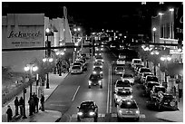 Central avenue with lots of cars and pedestrican on street. Hot Springs, Arkansas, USA ( black and white)