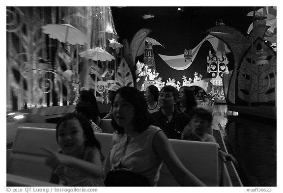 Families in indoor boat ride, Magic Kingdom. Orlando, Florida, USA (black and white)