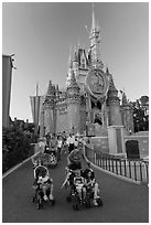 Mothers pushing strollers, Magic Kingdom. Orlando, Florida, USA (black and white)