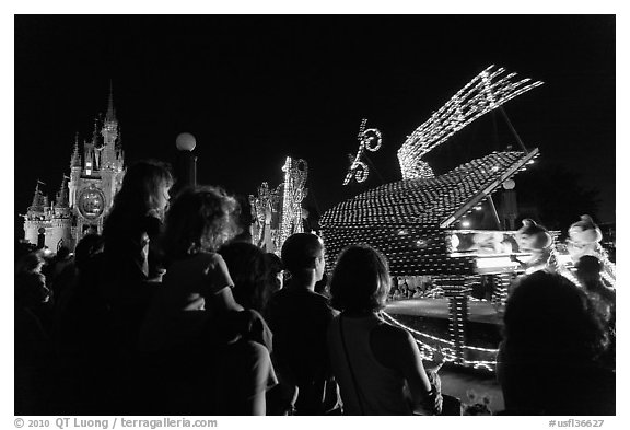 Families watching night parade, Magic Kingdom. Orlando, Florida, USA (black and white)