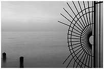 Grid and pilings and sunrise. Key West, Florida, USA (black and white)