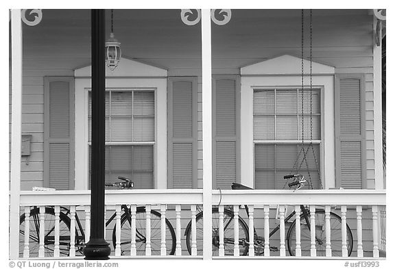Bicycle on pastel-colored porch. Key West, Florida, USA (black and white)