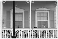 Bicycle on pastel-colored porch. Key West, Florida, USA ( black and white)