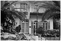 Facade of Hemingway's house. Key West, Florida, USA (black and white)