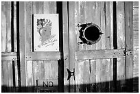 Wooden door with cuba poster. Key West, Florida, USA (black and white)