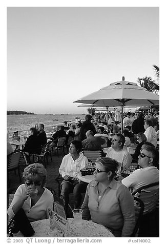 Crowds celebrating sunset at Mallory Square. Key West, Florida, USA (black and white)