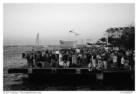 Crowds watching sunset at Mallory Square. Key West, Florida, USA (black and white)
