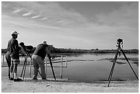 Photographers with big lenses, Ding Darling NWR, Sanibel Island. Florida, USA ( black and white)