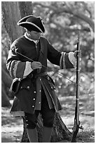 Man useing ramrod on musket, Fort Matanzas National Monument. St Augustine, Florida, USA (black and white)