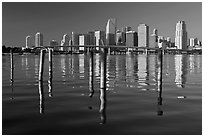 Bridge, pillings, and downtown skyline, Miami. Florida, USA ( black and white)