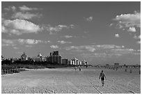 People strolling on South Beach, Miami Beach. Florida, USA ( black and white)