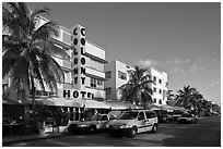 Taxi cabs and row of hotels in art deco architecture, Miami Beach. Florida, USA ( black and white)