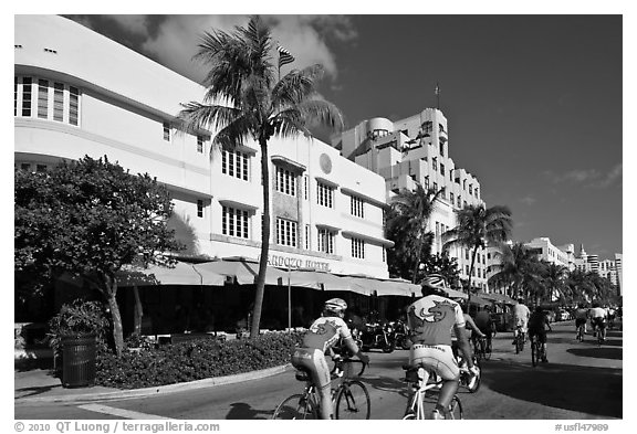 Cyclists passing Art Deco hotels, Miami Beach. Florida, USA (black and white)