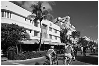 Cyclists passing Art Deco hotels, Miami Beach. Florida, USA ( black and white)