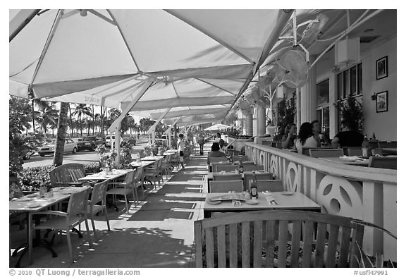 Outdoor restaurant tables, South beach, Miami Beach. Florida, USA (black and white)