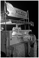 Food stall selling conch fritters on Mallory Square. Key West, Florida, USA ( black and white)