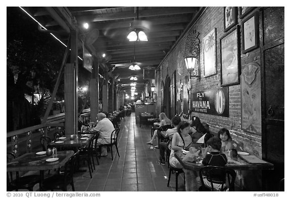 Outdoor dining at Cuban restaurant, Mallory Square. Key West, Florida, USA (black and white)