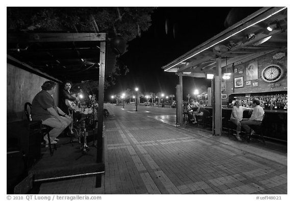 Salsa musicians and bar at night, Mallory Square. Key West, Florida, USA (black and white)