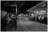 Salsa musicians and bar at night, Mallory Square. Key West, Florida, USA ( black and white)